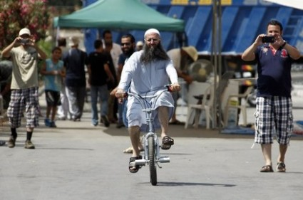 https://moulahazat.files.wordpress.com/2013/06/ahmad-al-assir-on-bicycle.jpg