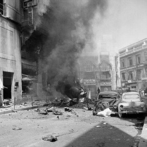 Smoke rises from the shattered wreckage of the large ABC department store. Scores of people were injured when a rebel bomb exploded in the crowded store. July 8, 1958. Lebanon was always a mailbox