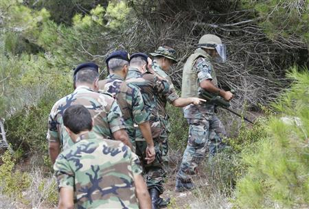 Lebanese Army soldiers near the site of the explosion close to the Lebanese-Israeli border (REUTERS/Ali Hashisho)