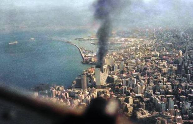 Plumes of smoke rise from the Holiday Inn Hotel in Beirut, Lebanon Dec. 15, 1975. (AP Photo)