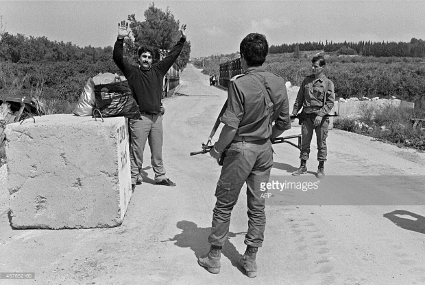 Israeli Defense Force (IDF) soldiers control 19 March 1985 a Shiite civilian at Kasmyah bridge after IDF evacuated in February about 500 sq km around Sidon (Saida), to the Litani river area, near Nabatiyah