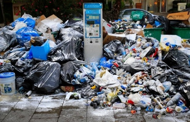 A parking meter is seen between a pile of garbage on a Beirut street, Lebanon, Tuesday, July 21, 2015. (AP/Hassan Ammar)