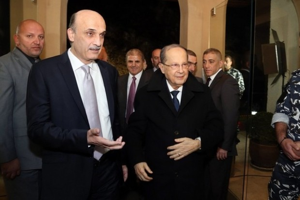 Samir Geagea (C-L) welcomes Michel Aoun (C-R) to his headquarters in Maarab, north-east of Beirut, on January 18, 2016. Aldo Ayoub, Lebanese Forces, AFP