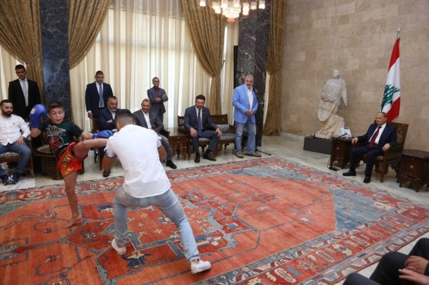 President Michel Aoun watch a demonstration match from the delegation of the Lebanese Union for Tai Boxing, in Baabda, Lebanon (Dalati Nohra)